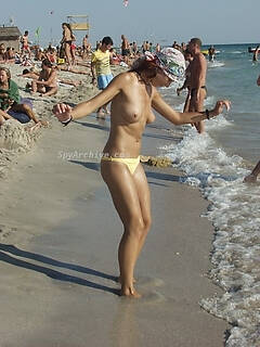 Spying on hot naked women on the beach
