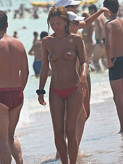 Nice mix of nude candid pictures taken on the beach
